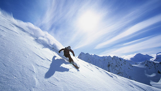 Skier Carving a Turn in Fresh Powder