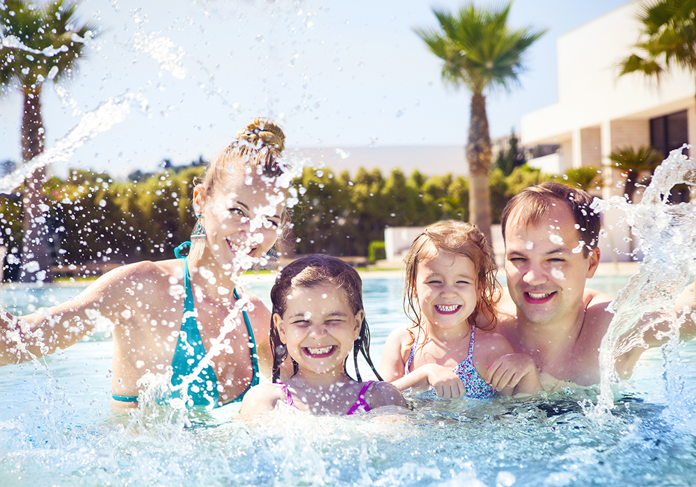 Family with Kids in Pool